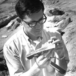 Geology student examining specimen