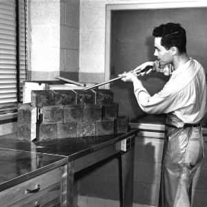 Handling radioactive sample, 1950s