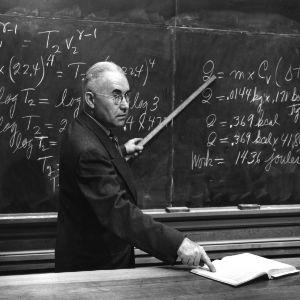 Dr. Rufus H. Snyder teaching at blackboard