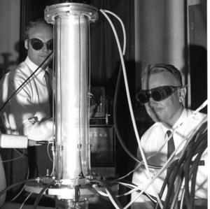 Wesley Doggett and Willard Bennett conducting physics research