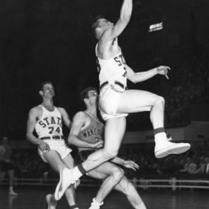 N.C. State player attempts a layup against Wake Forest, 1952