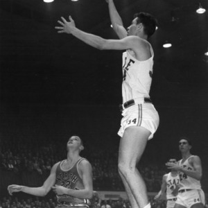 N.C. State takes jump shot against UNC-Chapel Hill, 1959