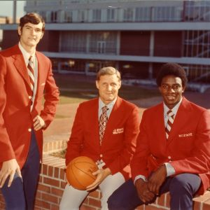 Coach Sloan and star players in the N.C. State basketball team's red jackets