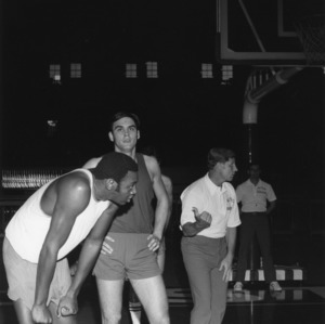 Players Phil Spence and Steve Walker and Coach Norm Sloan at practice, N.C. State University basketball