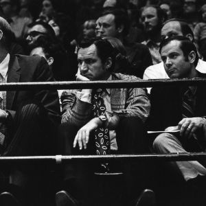 Dean Smith, coach of the North Carolina Tar Heels scouts the Wolfpack in Reynolds Coliseum
