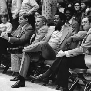 N. C. State men's basketball coaching staff on sidelines during game