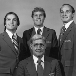 Head basketball coach Norm Sloan and assistant coaches, Monte Towe, Marty Fletcher, and Gary Stokan