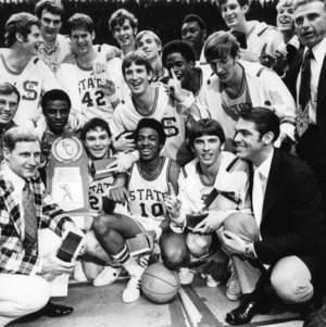 N. C. State basketball team, NCAA champions, after game with trophy