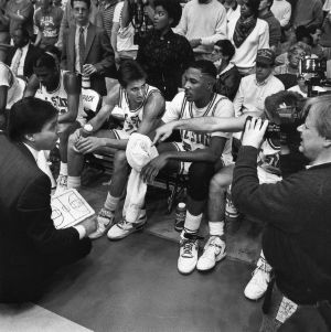 N.C. State basketball's Head Coach Jim Valvano giving instructions to players