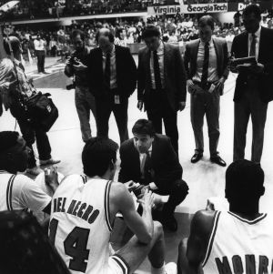 N.C. State basketball's Head Coach Jim Valvano is giving instructions during time out