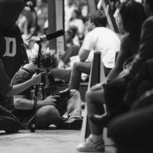 Camera man at N.C. State vs. Duke game