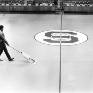 Man waxing the gym floor
