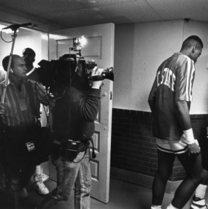Press following basketball team to lockeroom