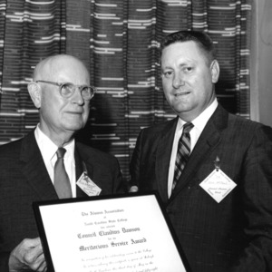 Claude Dawson receiving meritorious service award from Dick Mephail of North Carolina State College Alumni Association, Alumni Weekend, May 1958.