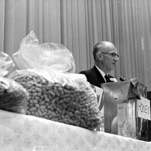 Alumni affairs director H. W. (Pop) Taylor speaking at a dinner in his honor, alumni weekend, 1965