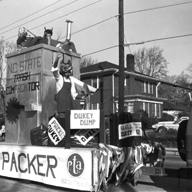 "Mu Beta Psi float depicting N.C. State trash ""compacktor,"" homecoming, 1982."