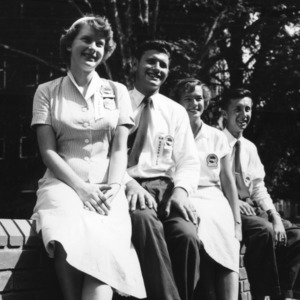 1954-55 North Carolina State 4-H Council officers sitting on a wall