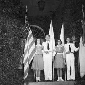1941 North Carolina State 4-H Council officers standing and holding flags