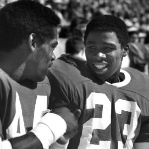 N. C. State football player Ted Brown talks to a teammate