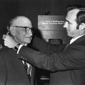 L. R. Harrill being awarded a medal at the Jane S. McKimmon Center at North Carolina State University