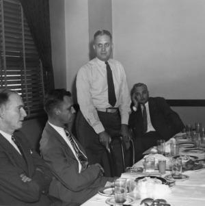 4-H leaders, C. F. Parrish (standing)