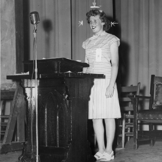 Ruth Moore, president of the North Carolina State 4-H Council in 1946, standing at a podium