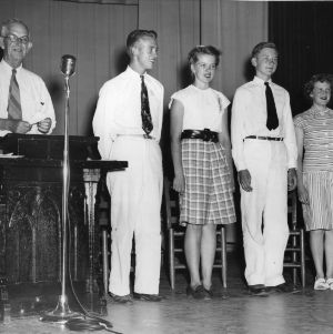 1946 North Carolina State 4-H Council officers standing on a stage