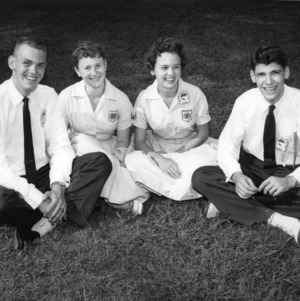 1959 North Carolina State 4-H Council officers sitting in the grass in July, 1959