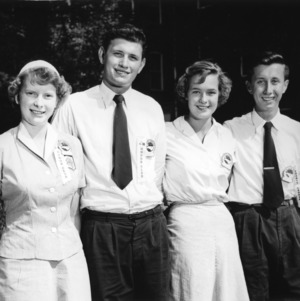 1954-55 North Carolina State 4-H Council officers leaning on a wall