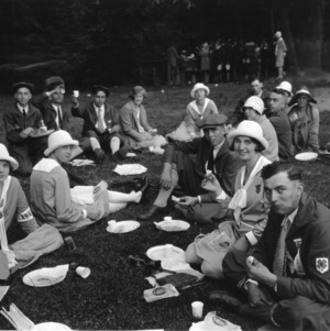 4-H club members eating at a picnic while attending North Carolina State 4-H Short Course at North Carolina State College