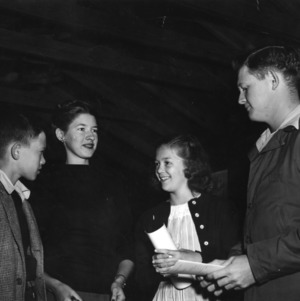 Four 4-H club members meeting together
