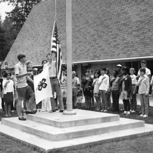 4-H club members raising the flag at the Betsy-Jeff Penn 4-H Educational Center