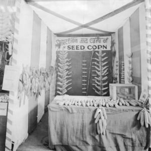 Gaston County exhibit demonstrating the selection and care of corn at the North Carolina State Fair