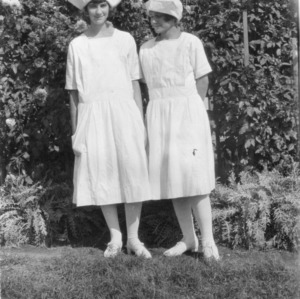 Two girls from Alamance County standing in club uniform at the North Carolina State Fair of 1923