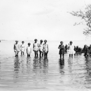 4-H club girls wading in water in Craven County, May 29th, 1931