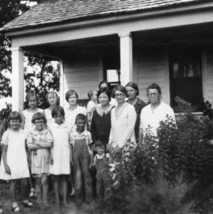 Mother and daughter club in Forest, North Carolina (Craven County) standing by a front porch