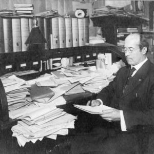Cassius R. Hudson at desk