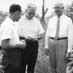 Chancellor John T. Caldwell and Dean of Agriculture H. Brooks James and other man on farm