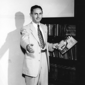 Roy L. Lovvorn holding the 1950 School of Agriculture annual report