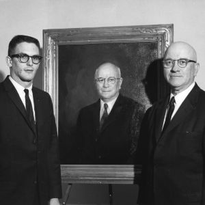 Burke Ellis, President of the Engineer's Council, with Dean J. Harold Lampe and portrait of Lampe