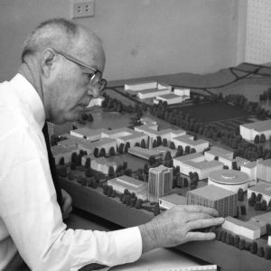 Carroll L. Mann, Jr. with model of campus