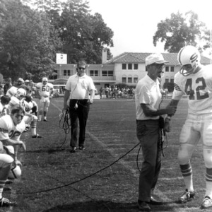 Coach Michaels talks to team captain Jack Whitley (42) during a game at UNC-Chapel Hill