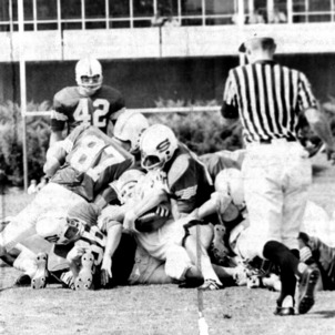 Tackle during N. C. State versus University of South Carolina football game