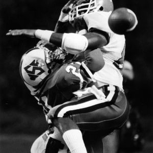 N. C. State football player Joe Johnson collides with a Maryland player