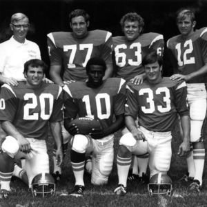 Members of the 1973 football team and coach Lou Holtz