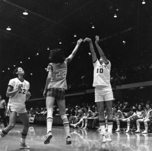 N.C. State's #10 Sherri Pickard takes a shot with State bench in background during women's basketball game
