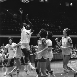 N.C. State's #51 Christine Chambers takes the shot as opponents look on