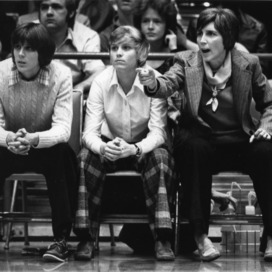 North Carolina State University women's basketball coaches Kay Yow and Nora Finch on sidelines