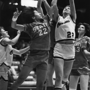 N.C. State's #22 Trudi Trice defends the basket against Carolina