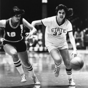N.C. State's #33 Ginger Rouse moves the ball down the court in a game against UCLA
